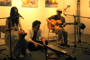 Tets-J (center) plays with Jibucon in Minami Machida on July 29, 2012