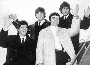 The Beatles with Jimmie Nicol (center) arrive in Sydney in June 1964.